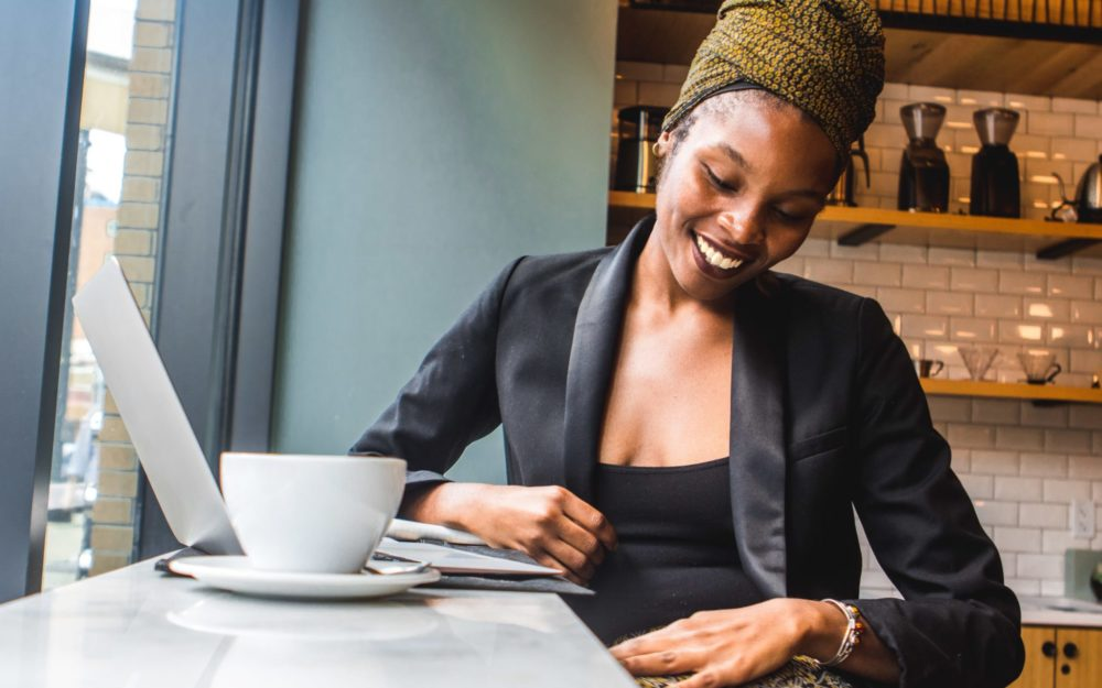 Stock image of Black woman working at a coffee shop